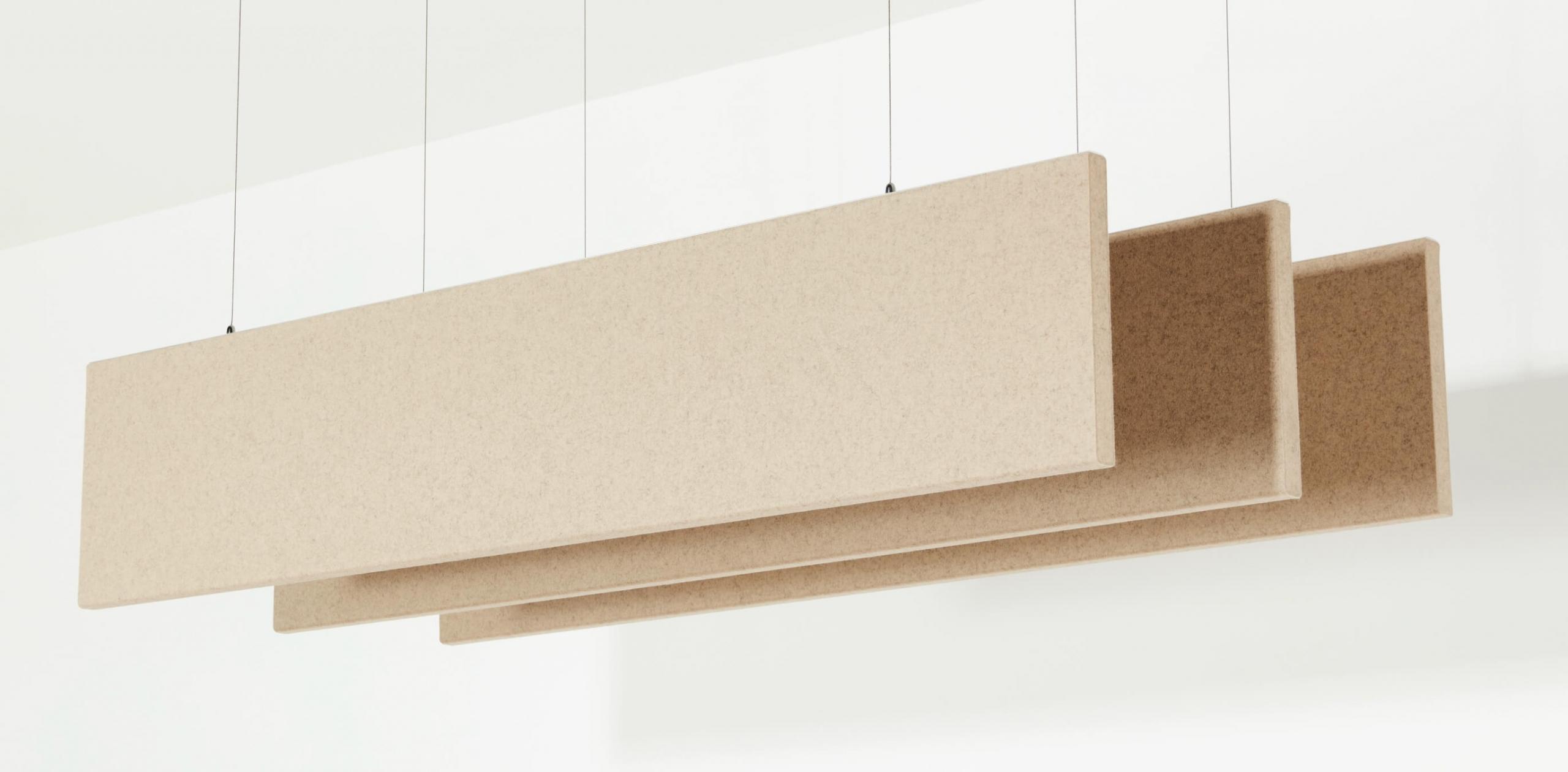 Display of 3 hanging linear baffles made of felt.