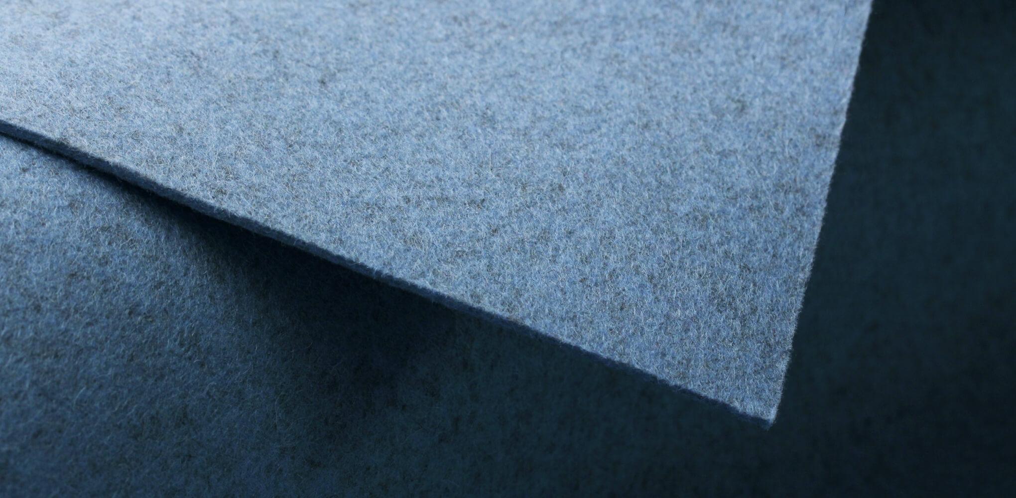 Macro photo of light blue wool felt